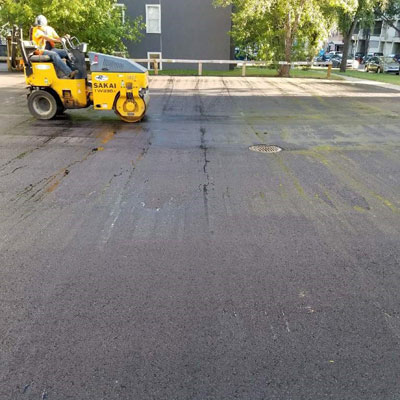 Paving a parking lot in downtown Saskatoon