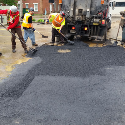 Pothole patching in a parking lot in the City of Saskatoon