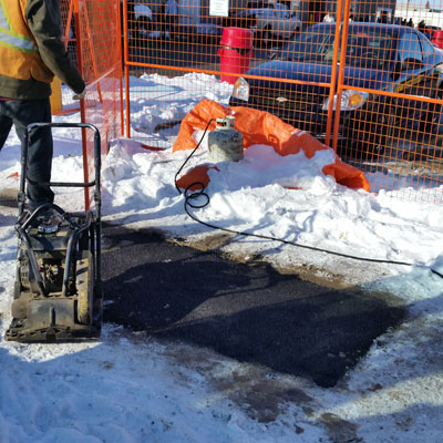 Repairing utility cuts at Costco in the winter with cold mix asphalt